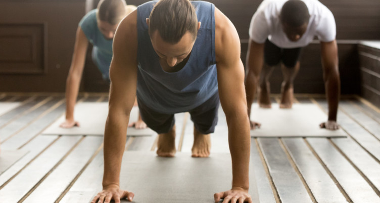 Group of people doing plank pose